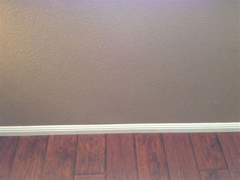 New Family room floors and walls. Select Surfaces Canyon