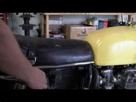 cafe racer build project part 10 1973 honda cb350f cb350 removing front wheel cafe race take videolike