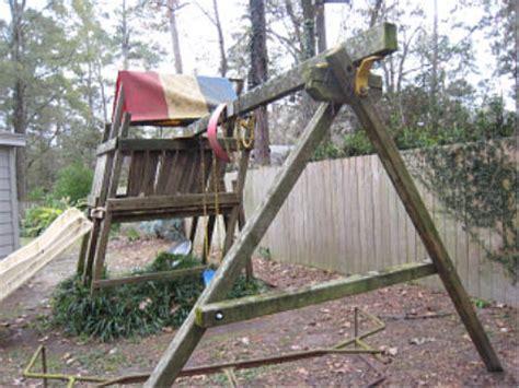 broken swing set broken wood fence hot tub swing set removal wilmington