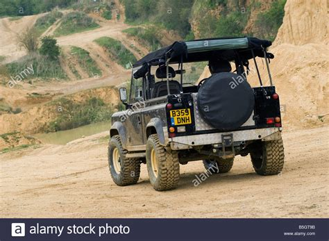 Stiker Mobil Defender 90 Pernik Offroad 4x4 rear view of a land rover defender driving road in the uk stock photo royalty free image