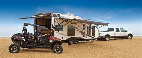 travel trailer with garage garage brands toy hauler buyer s guide www trailerlife com