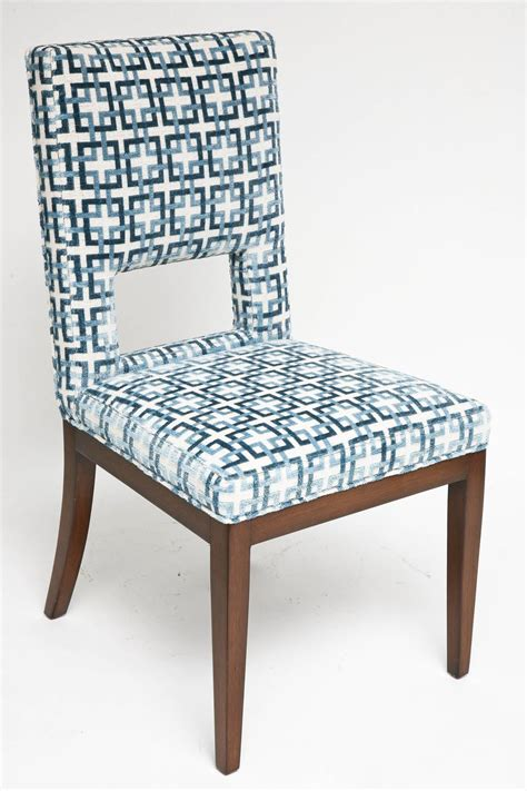 set of eight dining chairs upholstered in blue and white