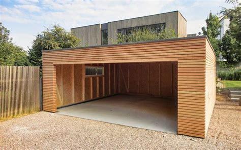 holzgarage naturhouse garage bois toit plat maison bois