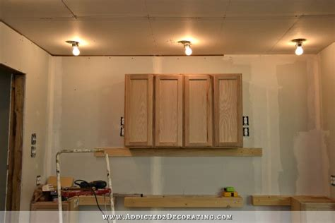 how to install upper kitchen cabinets how to install upper cabinets manicinthecity