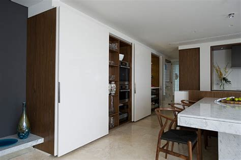 sliding door design for kitchen small space solutions hidden kitchen from minosa design