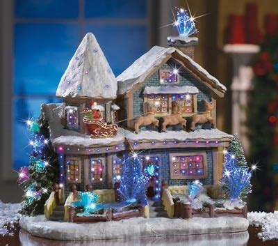 holiday lighted christmas village house toys santa
