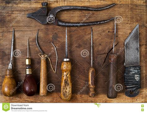 Handmade Leather Tools - leather craft tools on a wooden background craftmans work