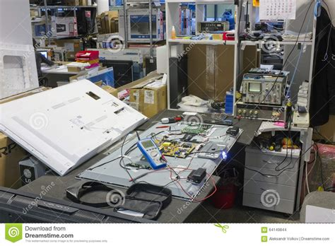 Small Serving Center 2 workplace on repair of all brands tvs editorial stock image image 64149844