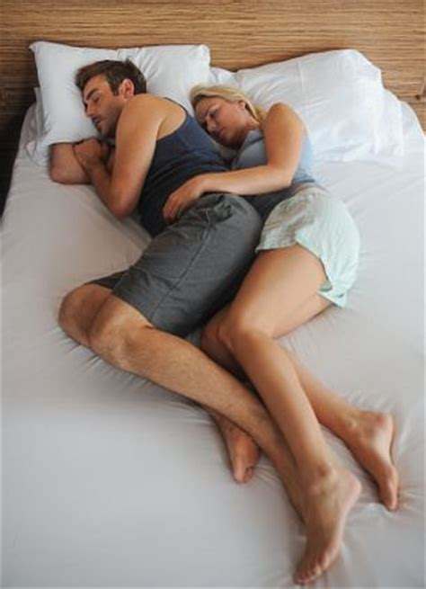 spooning in bed what your sleeping positions tell about your relationship