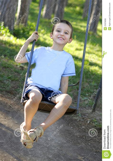 play boy swing videos boy sitting on a swing stock photo image of caucasian