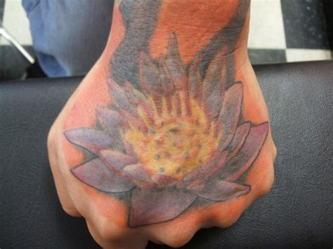 lotus tattoo in hand tattoo ideas by marguerite cooke