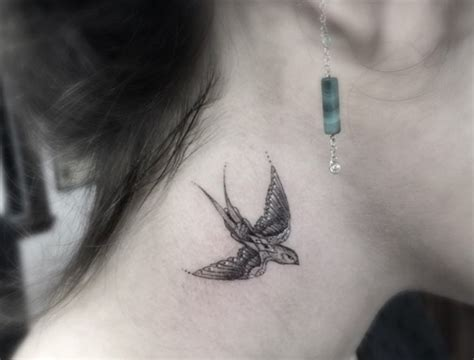 bird tattoo on neck 43 lovely neck birds tattoos