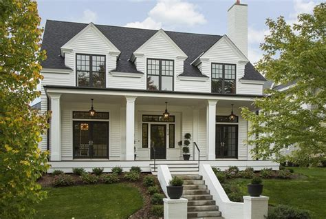 white house with black windows st paul custom home transitional exterior