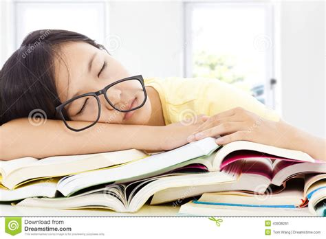 the sleeping books tired student with glasses sleeping on the books
