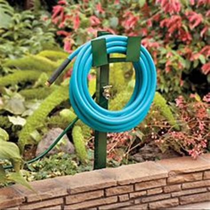 Garden Hose Hanger With Faucet by Garden Hose Holder Hose Holder And Garden Hose On