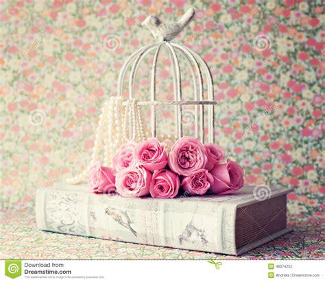 imagenes navideñas vintage roses over vintage book stock photo image 48074252