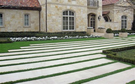 driveway large linear stone bands  grass spacing