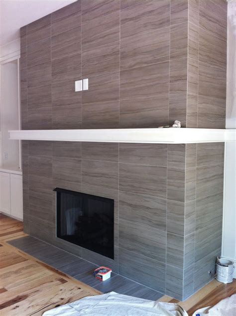 tile fireplaces on fireplaces jl 12x24 porcelain tile on fireplace wall and return walls floor to ceiling tile we ve