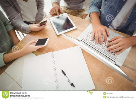 people section mid section of business people using laptop and