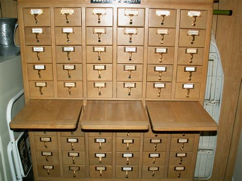 library card catalog card catalog curled up with a book