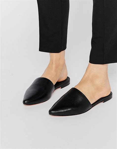 ware house shoes lyst warehouse slip on mules black in black