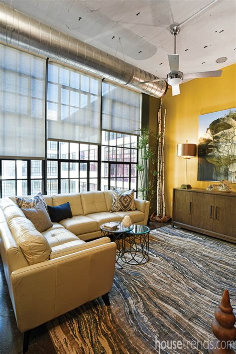 living room dayton yellow wall creates a cheery focal point