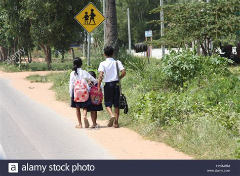 school children walking home safe stock photo royalty