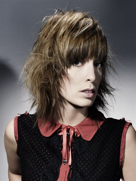 wearable layered hairstyle with thick curved bangs and