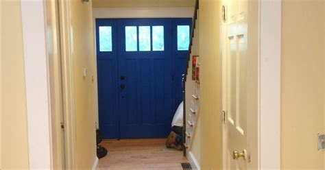door is behr color blue walls are behr color pale honey and trim is behr color heavy