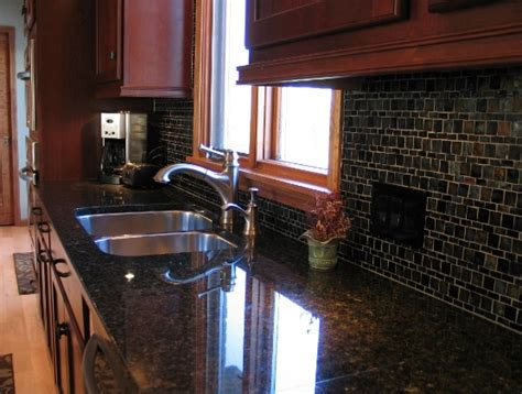 backsplash with cherry cabinets cherry kitchen cabinets with gray wall and quartz