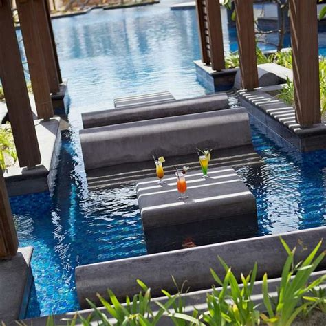 pool benches luxury and contemporary hotel built with natural elements