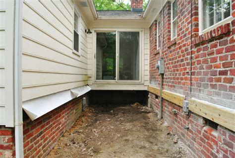 can you brick a house with siding how to build a deck making our post holes young house love