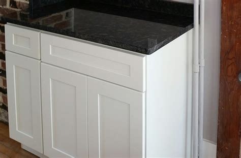 white shaker cabinets with granite steel grey granite white kitchen cabinets with uba tuba