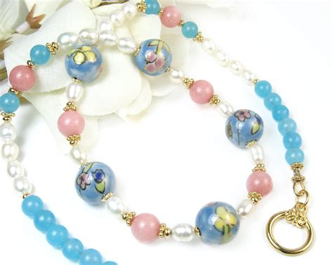 Gemstone Lariats From Sweet Sky Jewelry by Blue Pink Flower Beaded Necklace Ceramic Floral Pearl