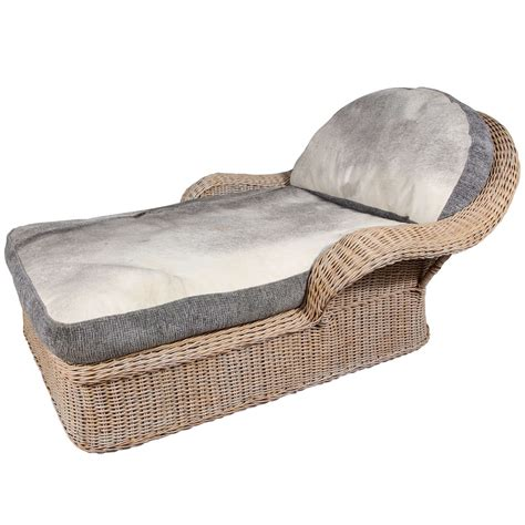 cowhide chaise rattan chaise with cowhide upholstery at 1stdibs