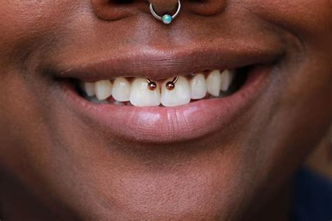 smiley piercing 44 peeps who are rocking their smile tips