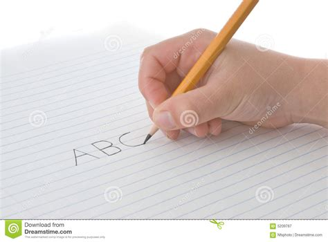 writing on paper child s holding pencil writing alphabet on paper