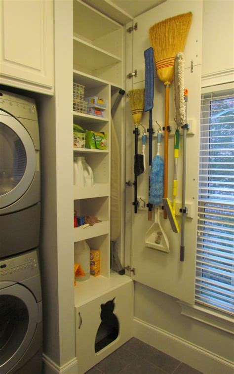 laundry rooms storage and doors laundry room pantry stacked washer dryer brooms on