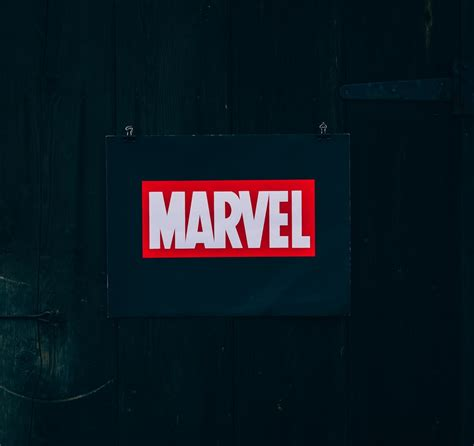marvel logo  black wooden board photo  logo image