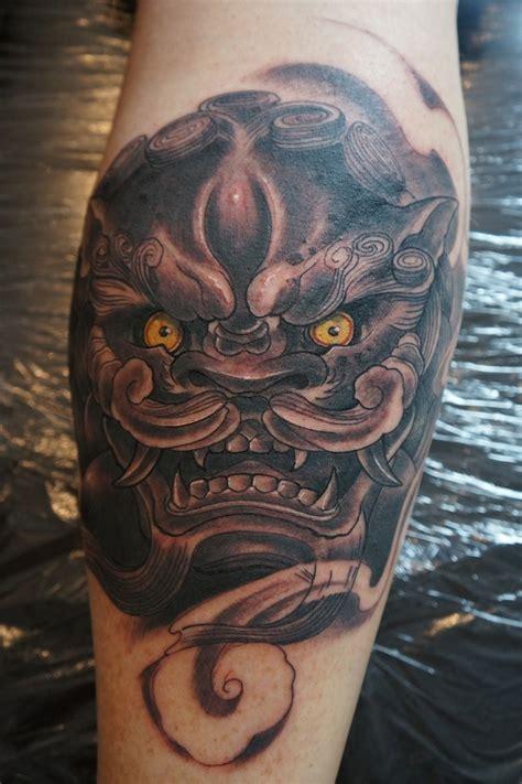chinese lion tattoo on leg by graynd tattooimages biz