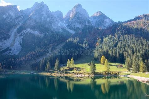 rugged scenery magnificent autumn scenery of lake gosausee with rugged rocky mountain peaks in the background