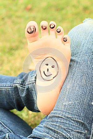 small faces  toes  sole royalty  stock image