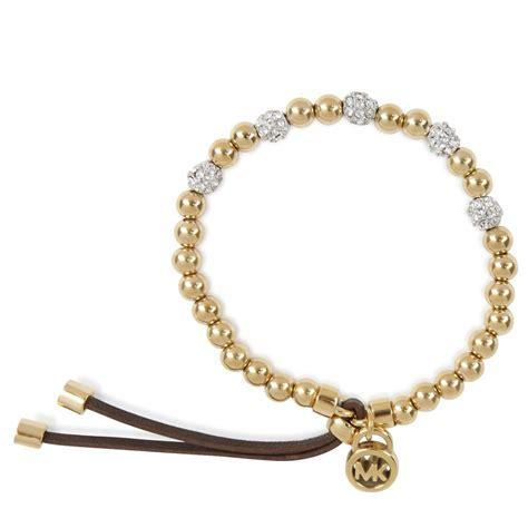 gold bead bracelet michael kors bead embellished bracelet in gold lyst