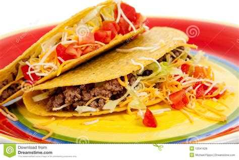 Making Floor Plans Free two tacos on a plate on a white background royalty free