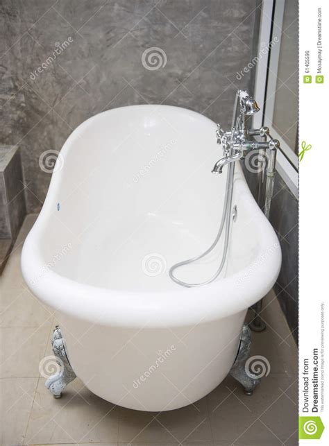 vintage bathtub with faucet and shower in bathroom stock