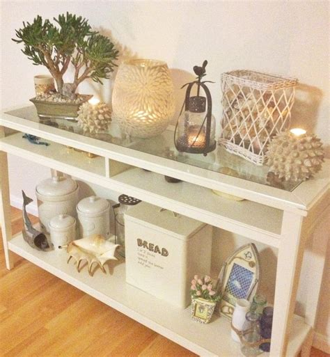 ikea hall table and candle knick knack display with a