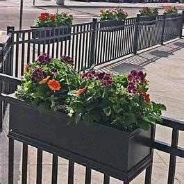 restaurant patio planters black railing planters on metal fence at local restaurant