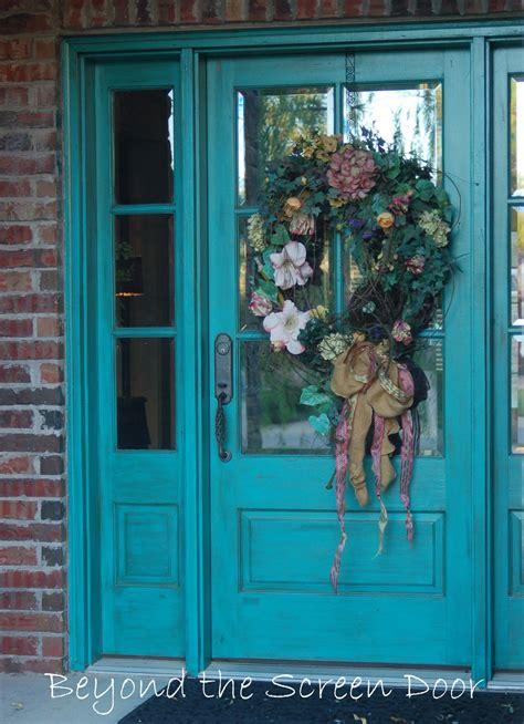 more turquoise front doors beyond the screen door