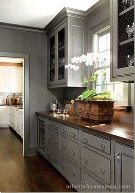 gray kitchen cabinets  dark butcher block counters