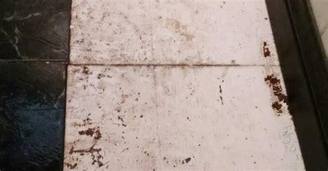 fixing uneven spots vinyl tiles on a kitchen floor